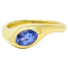 1990s Vintage 0.70 CTW Tanzanite 18 Karat Gold Eyelet Band Ring