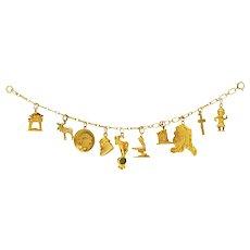 Art Nouveau 10 Karat Gold Alaskan Gold Rush Charm Bracelet