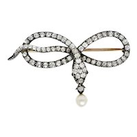 1860's Victorian 2.00 CTW Diamond Pearl Silver-Topped 14 Karat Gold Snake Love Knot Brooch