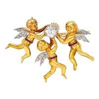 Edwardian Diamond Ruby Platinum-Topped 18 Karat Gold Cherubic Pendant Brooch
