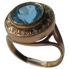 9 kt Pink Gold Roun Blue Topaz and Multi Diamond Ring