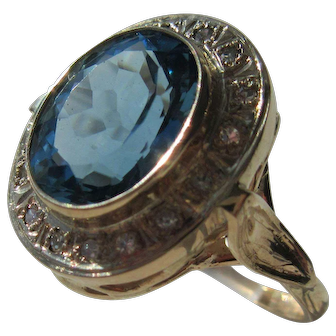 Oval Blue Topaz and Multi Diamond Ladies Gold Ring