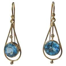 Blue Topaz and Diamond Dangle Gold Earrings