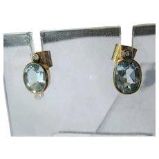 Oval Light Blue Topaz Stud Earrings