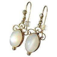 9 kt Yellow Gold Oval Light Grey Moonstone and Diamond Dangle Earring