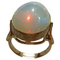 14kt. Yellow Gold Flaming Fiery Large Oval Opal and Diamond Ladies Ring