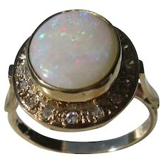 18 kt Yellow Gold Fiery Oval Opal and Diamond Ladies Ring