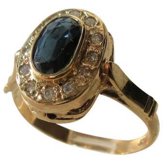 Oval Faceted Sapphire and Multi Diamond Ladies Gold Ring