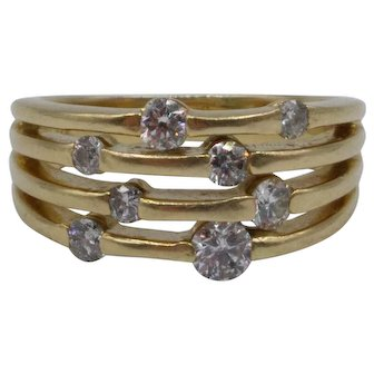 0.68 Carat Bar-Set Diamond Ring set in 14K Yellow Gold