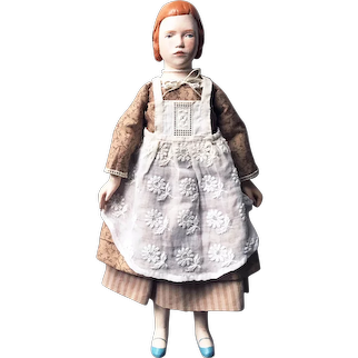 Wooden doll in a white apron