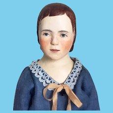 Wooden art doll in Blue dress