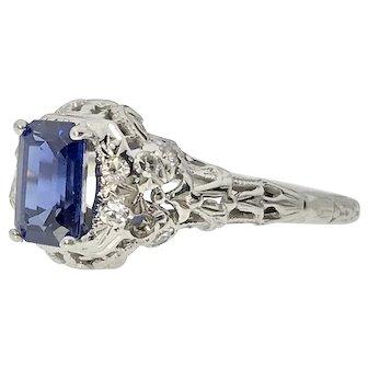 Unique 18kw Ring w/ Emerald Cut Sapphire
