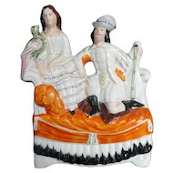 Staffordshire Couple on Sofa With Parrot and Stringed Instrument c 1860