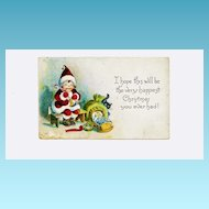 c1918 Christmas Saint Nicholas Cartoon Greeting Vintage Postcard – Child Santa Claus Putting Candy Cane in Doll Stocking –  Sleeping Doll in Cradle – Christmas Eve, Brooklyn NY Postmark