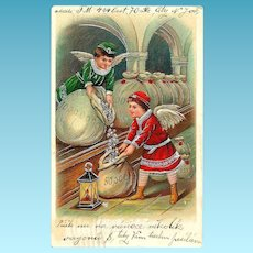 1909 CHRISTMAS / NEW YEAR Holiday Postcard - Winged Angel Boys Filling Bags with Silver Coins - European Holiday Gift-Giving Tradition - Embossed with Bright Silver Accents, Trim & Lettering - December 23, 1909 New York City Postmark