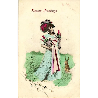 c1907 Vintage Easter Greeting Colored-Photo Postcard – European Hare-Style Easter Rabbit - Young Woman in Easter Parade Bonnet and Dress with Spring Flowers - Made in Austria
