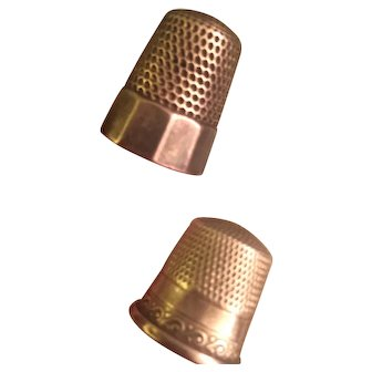 Two sterling thimbles