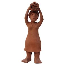 1950s Folk Art African Terracotta Figurine of a Woman Carrying Wooden Branches