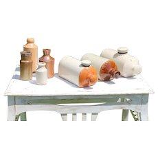 Antique Set of Seven Stoneware Bottles, English and Scottish