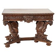 A Continental Renaissance Revival Carved Oak Center Table, Late 19th Century