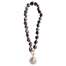 Tahitian cultured Pearl necklace with Sterling Silver harmony bell