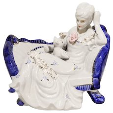Gilded Blue and White Porcelain Lacey lady with cat on couch figurine