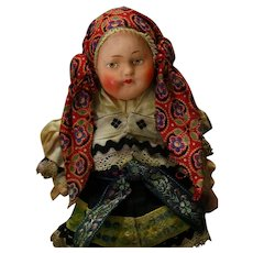 Pretty fabric doll  in a folk costume about 8 1/2 inches