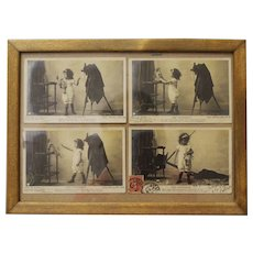 French postcards in a frame under the glass