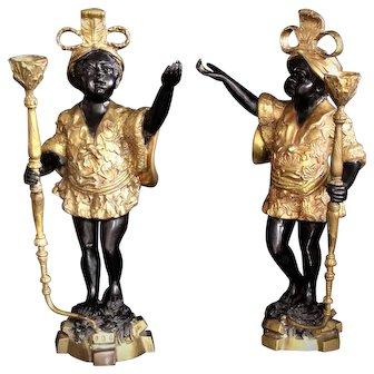 Pair of antique bronze Venetian blackamoor candle holders