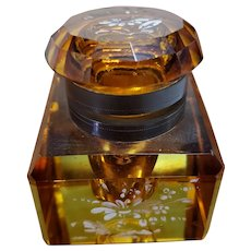 Amber hued cut glass inkwell with enamel