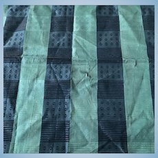 Green and black silk fabric c1860