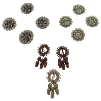 A collection of 11 Victorian handmade embroidered wheel appliqué trims decorations