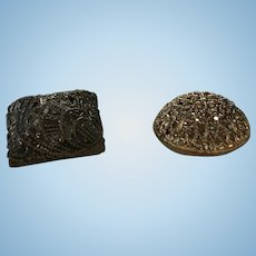 2 Czechoslovakian filigree metal mirror backed buttons one round one square