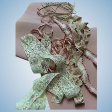 A collection of related trims for doll dresses