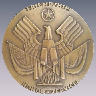 Rich's 75th anniversary bronze medal by Julian H. Harris. C. 1942