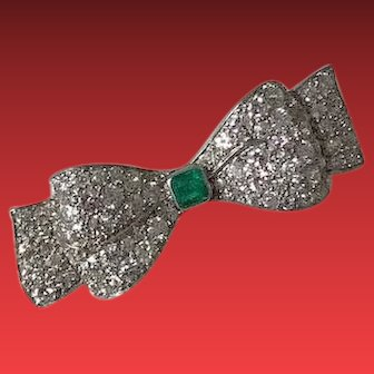 A Platinum and 18KG Emerald and Diamond Bow Brooch