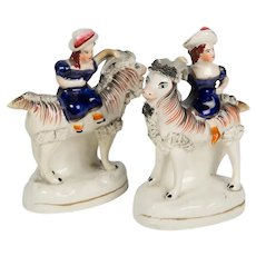 Pair of Staffordshire Figures of Children Riding Goats