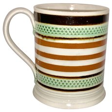 A Mochaware Mug Slip Banded and Rouletted England circa 1810