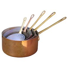 A set of Vintage French Copper Sauce Pans