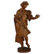 A large limewood statue of a musician angel, Bohemia(?) 18th c.