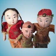 Three circa 1920 Chinese Papier Mache Dolls with Original Silk Costumes