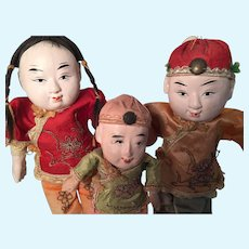 Three circa 1920 Chinese Papier Mache Dolls with Original Silk Costumes