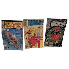 Three Vintage Marvel Comic Books Including 'Heathcliff becomes Santa Claus'
