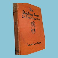 Circa 1940s 'Bobbsey Twins in the Country' Hard Covered Book