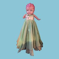 Celluloid Googly-Eyed Pillow Doll with a long Green Crepe Paper Dress