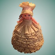 Celluloid Doll in Original Crepe Paper Dress and Bonnet