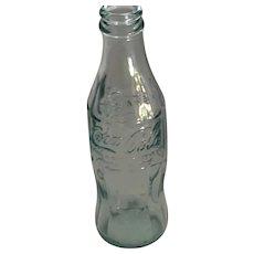 1991 8 oz. Pale Blue-toned Embossed Coca-Cola Bottle