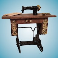 Vintage Miniature Treadle Sewing Machine with Brass Scissors and a Dress Pattern
