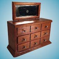 Miniature Three Drawer Mirrored Wooden Dresser.