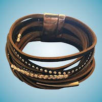 Circa 1970s - 80s Thirteen Band Metal and Rhinestone Embellished Leather Bracelet